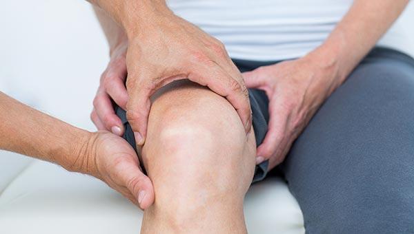 Examining man's knee