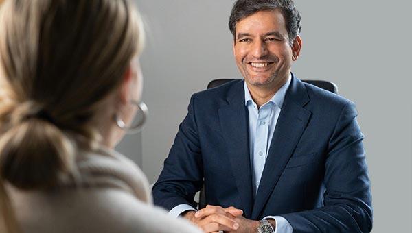 Consultant surgeon Mr Ali Noorani with patient