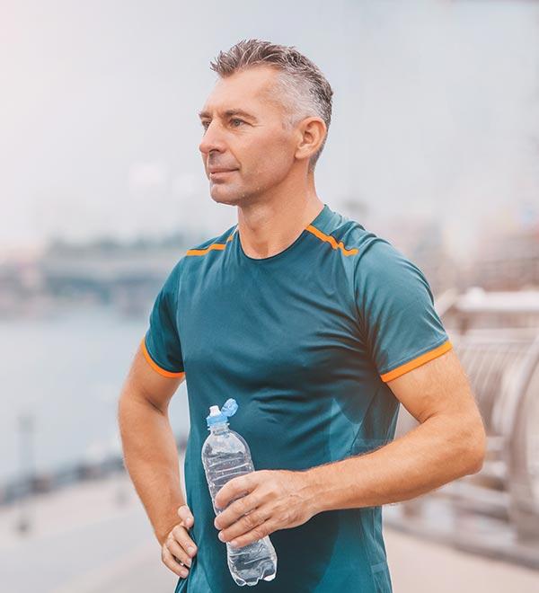 Male runner holding water bottle
