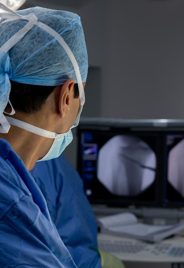 Surgeon examining x-ray