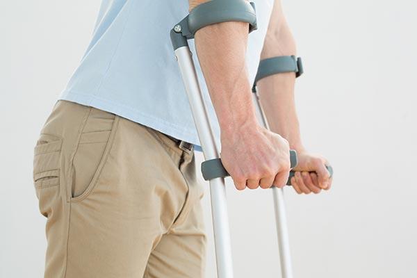 man walking on crutches
