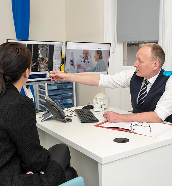 Consultant with patient showing xray