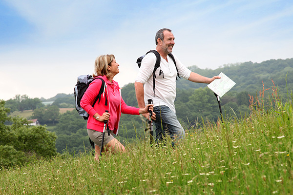 Middle aged couple walking up a hill