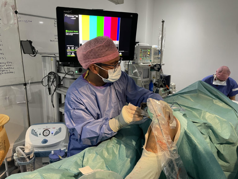 Suresh Sudela in action with the ultrasound in theatre